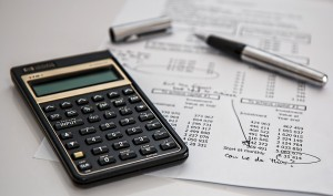calculator next to tax sheets