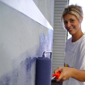 homeowner painting condo walls