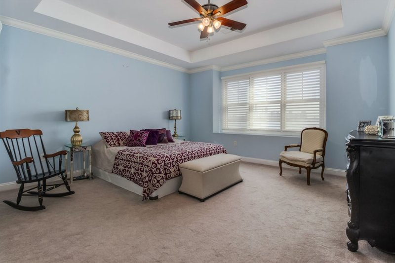 bedroom with new carpets and crown molding