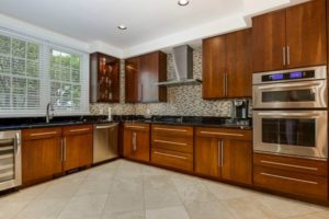 gourmet kitchen in Port Liberte condo for sale