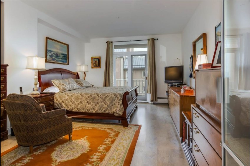 master bedroom in Port Liberte condo for sale