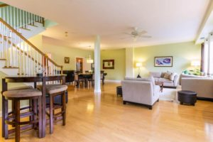 spacious living room in Port Liberte townhome for rent