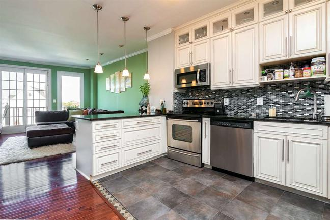 beautiful gourmet kitchen in port liberte waterfront home for sale