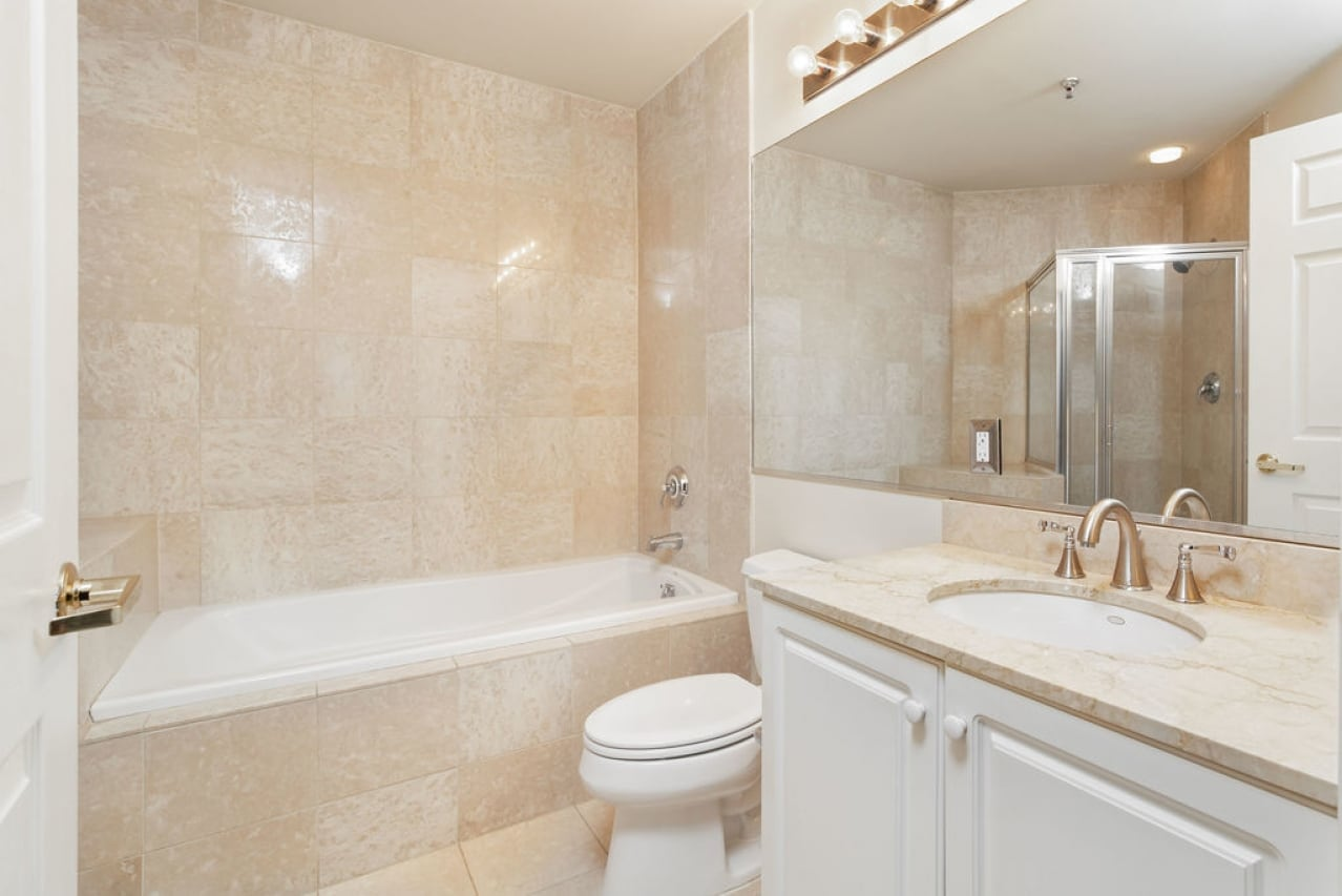 Luxury bathroom with soaking tub, glass shower.