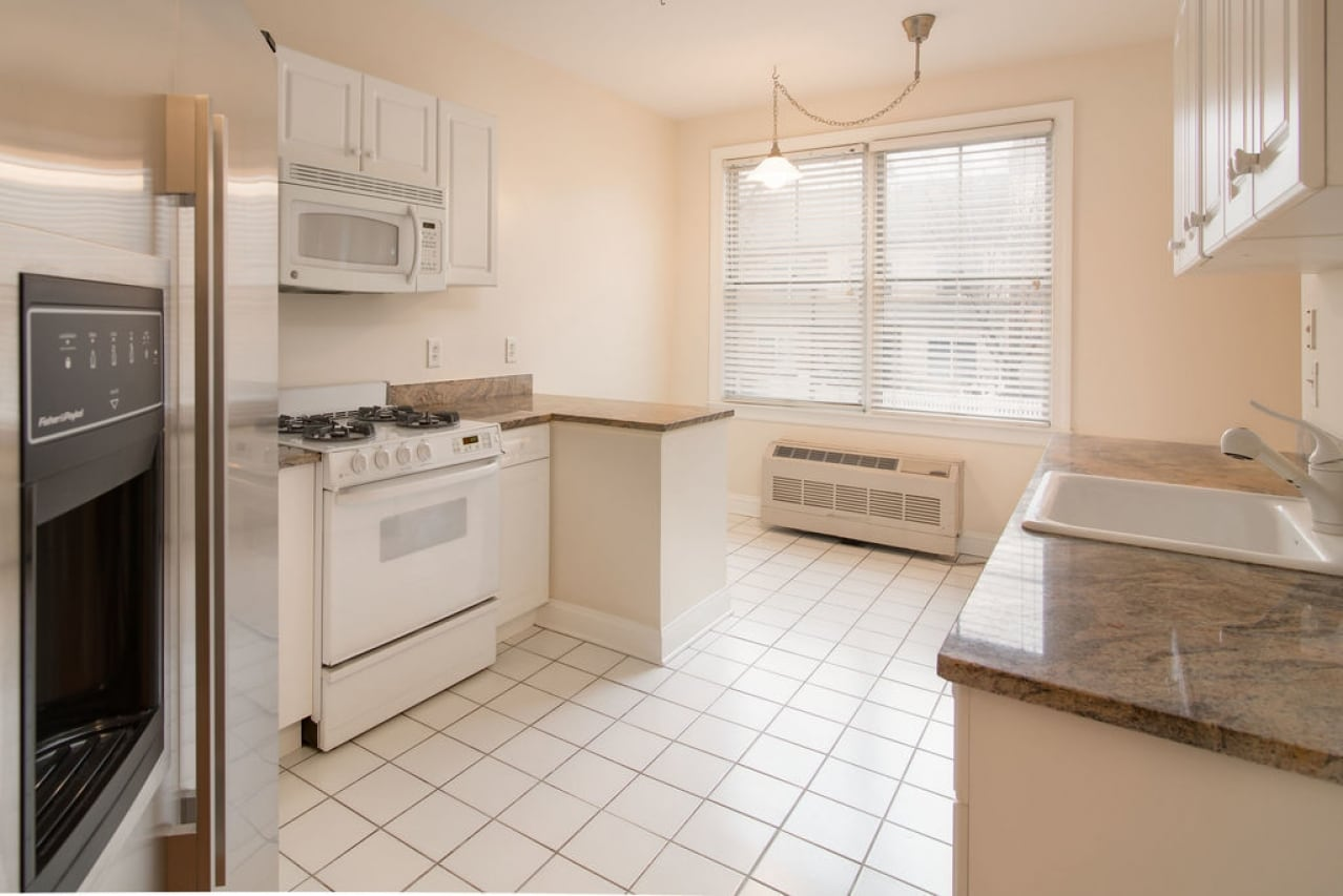 Large kitchen with tile floor.