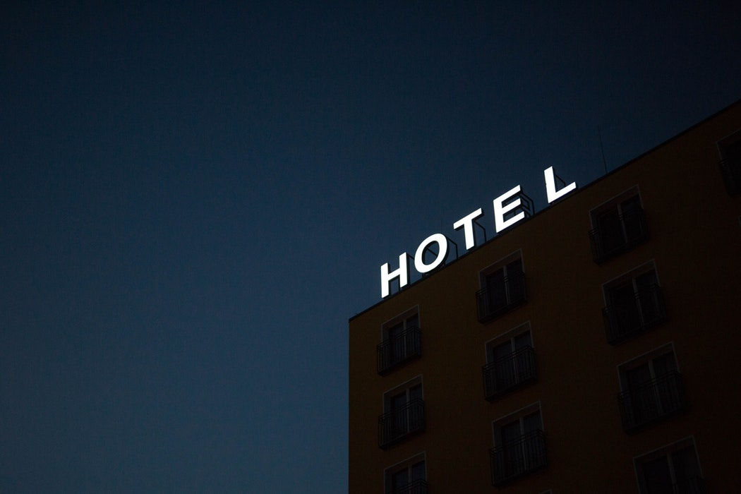 A glowing hotel sign.