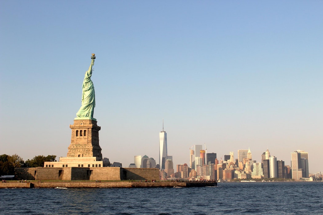 The Statue of Liberty and Manhattan skyline.